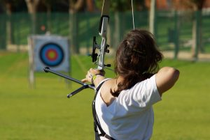 Woman shooting bow and arrow