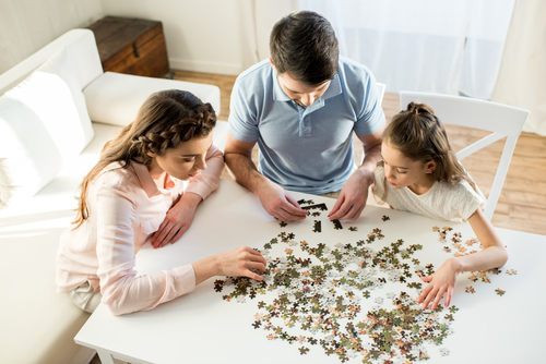 Family playing puzzle