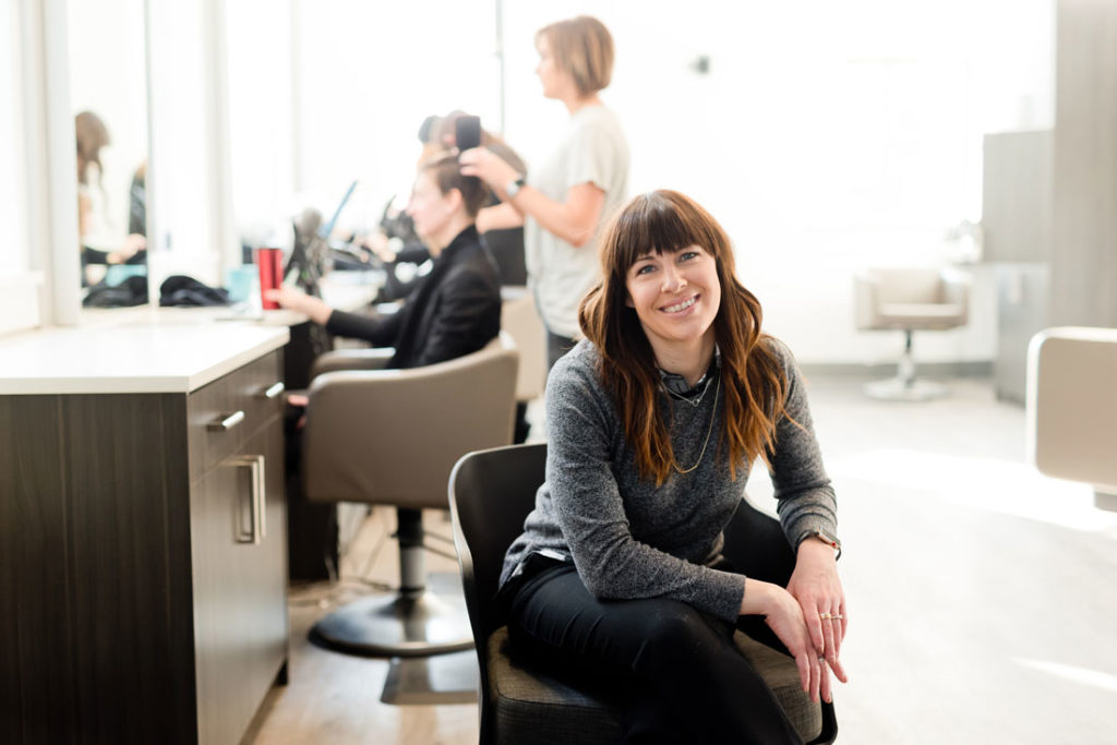 Friendly looking business owner in here hair salon