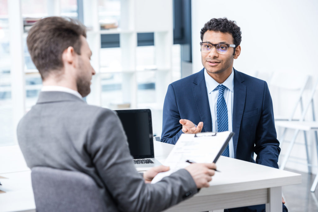 One man interviewing another is a business setting